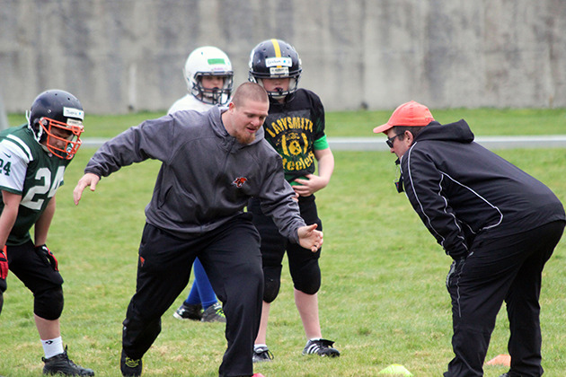 Defensive techniques are demonstrated by B.C. Lions' Adam Bighill during Sunday Cowichan football camp sessions at Duncan Christian School that attracted a lot of players. — image credit: Don Bodger