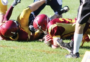 Cowichan's Riley Caljouw (right) recovers a Chilliwack Giants fumble.   Photograph By Kevin Rothbauer/Citizen
