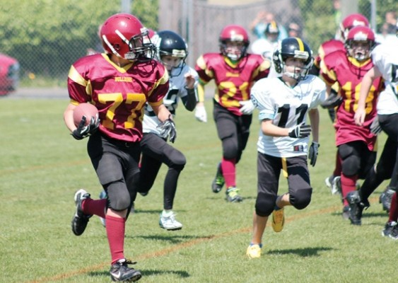 Peewee Bulldogs running back Zach Pearson (77) gains yards during the first half of his team's game against Ladysmith.   Photograph By Kevin Rothbauer/Citizen