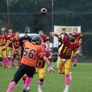 Braemon Conville throws a touchdown pass to teammate Kain Melchior.— Image Credit: Kevin Rothbauer/Citizen