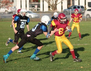 Receiver Kilion VennRyan gains some late-game yards for the Bulldogs last Sunday.— Image Credit: Kevin Rothbauer/Citizen
