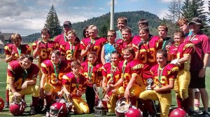 The peewee Cowichan Bulldogs celebrate with the Founders Cup after their win last Saturday.— Image Credit: Ted Harris Photo