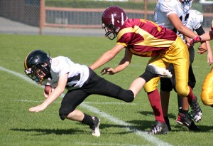 Junior bantam Bulldogs lineman and team captain Jordan Russell takes out the Ladysmith quarterback during last Sunday's game at McAdam Park.— Image Credit: Kevin Rothbauer/Citizen