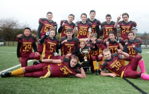 The junior bantam Bulldogs celebrate beating Ladysmith in Monday's Island final. (Kevin Rothbauer/Citizen)